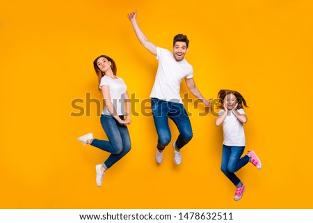 Full length body size view of three nice attractive slim fit sporty cheerful cheery childish person active activity motion having fun good mood isolated over bright vivid shine yellow background