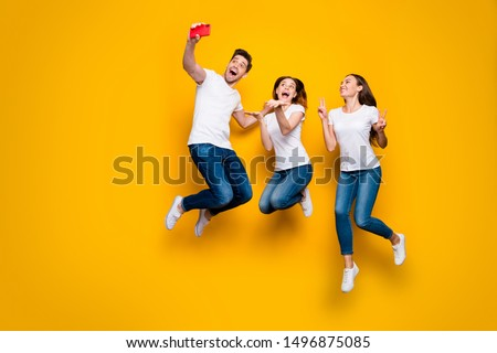 Full length body size view of three nice attractive slim fit sporty cheerful cheery person having fun taking selfie showing v-sign isolated over bright vivid shine yellow background
