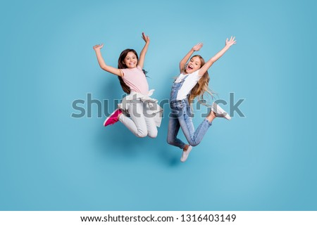 Full length body size view of two people nice-looking crazy lovely attractive cheerful carefree straight-haired pre-teen girls having fun great weekend time overjoy isolated over blue background #1316403149