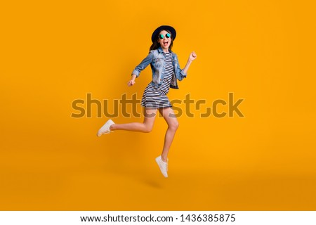 Full length body size view photo careless carefree childish millennial summer travel vacation laughter scream celebrate specs eyewear eyeglasses striped jeans denim clothes isolated vivid background #1436385875