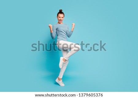 Full length body size view photo careless carefree playful satisfied lady scream yeah raise hands fists luck lucky lottery aims funny funky pullover white trousers sneakers isolated blue background #1379605376