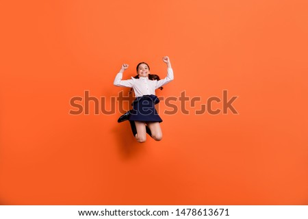Full length body size view photo charming crazy kid raise fists lucky competition contest white shirt blouse stylish pigtails ponytails boots long socks tails dress isolated orange vivid background