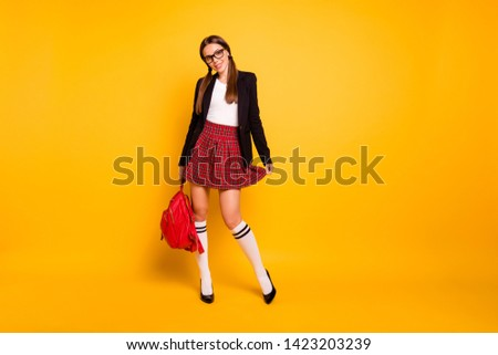 Full length body size view photo cute attractive lady long tails  back school academic content enjoy touch dress checked eyewear eyeglasses white knee-socks isolated yellow background plaid long