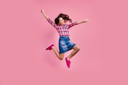 Full length body size view photo delighted funny lady people young person raise hands fists scream yeah achievement content isolated wear fashionable plaid denim jeans skirt outfit pastel background