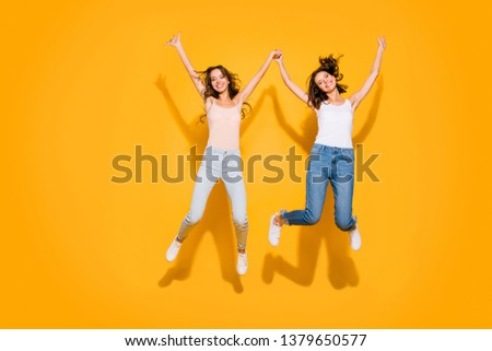 Full length body size view photo lovely sweet teens people beautiful summer travel weekends holiday free time foolish hipsters satisfied glad long hair checked jeans shirts isolated yellow background