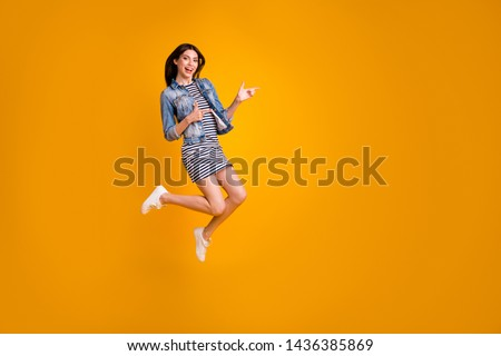Full length body size view photo of careless playful funny person foolish indicate present choose decide advise ads adverts wear striped denim cool clothing summer isolated bright background