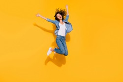 Full length body size view photo playful childish cute lady move holidays glad laughter raise hands travel summer candid freedom active energetic denim suit sneakers legs isolated vibrant background