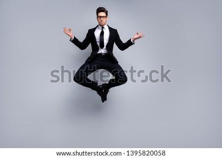 Full length body size view portrait of nice attractive calm guy executive leader expert development agent broker manager financier banker weightlessness zero gravity isolated on light gray background