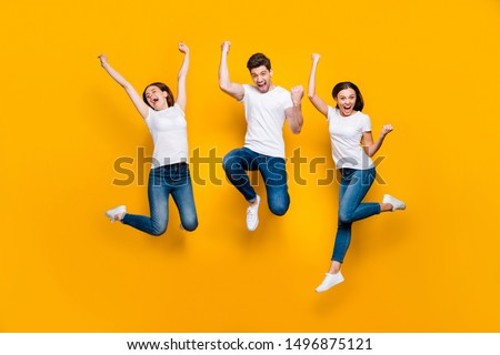 Full length body size view portrait of three nice attractive lovely slim sporty satisfied cheerful cheery ecstatic person buddy fellow having fun isolated over bright vivid shine yellow background