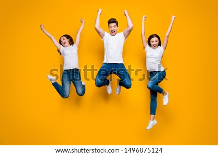 Full length body size view portrait of three nice attractive lovely slim strong sporty satisfied overjoyed cheerful cheery person having fun isolated over bright vivid shine yellow background Foto stock ©