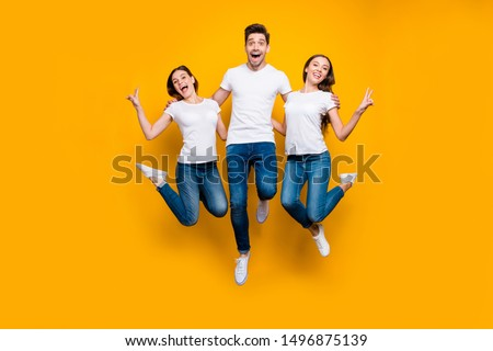 Full length body size view portrait of three nice attractive slim fit cheerful cheery person buddy fellow having fun showing v-sign isolated over bright vivid shine yellow background #1496875139