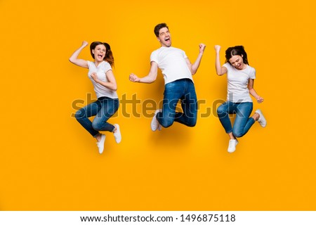 Full length body size view portrait of three nice attractive strong sporty satisfied cheerful cheery person having fun celebrating attainment isolated over bright vivid shine yellow background