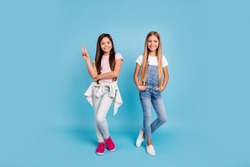 Full length body size view portrait of two people nice lovely charming attractive cheerful straight-haired pre-teen girls siblings showing v-sign isolated on blue turquoise background