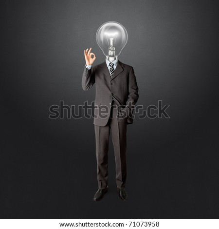 full length business male with lamp-head in suit shows OK