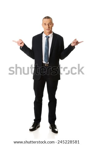 Full length businessman with hands on both sides.
