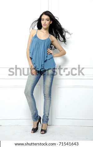 Full length casual picture of young sexy woman in blue jeans