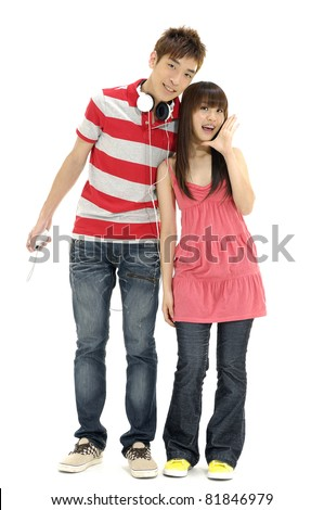 Full length casual young couple with headphones having fun