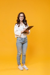Full length cheerful young business woman in white shirt glasses isolated on yellow background studio. Achievement career wealth business concept. Mock up copy space. Hold clipboard papers document