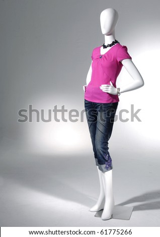 full-length collection of dress on mannequin in light background