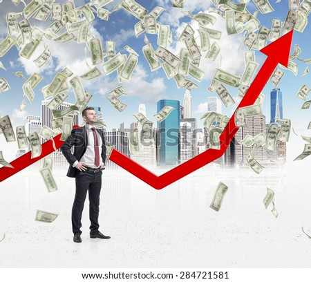 Full-length confident businessman stands among falling dollar bills from the sky. Red arrow is going up as a symbol of the growth in economy. New York sketch background.