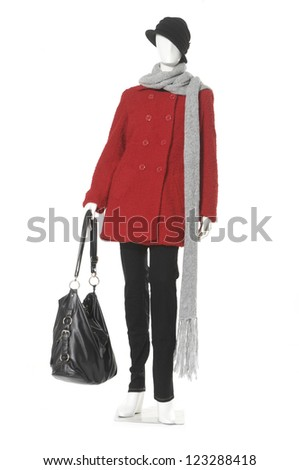 full length Fashion female red coat with hat and bag on a mannequin