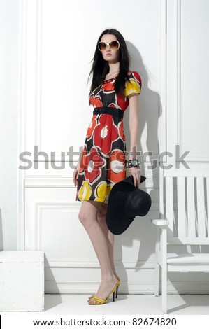full-length fashion model in fashion dress posing in the studio