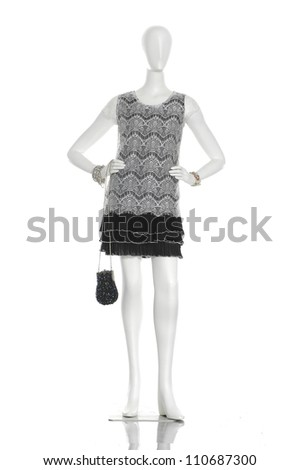 full-length female clothing with black bag on mannequin