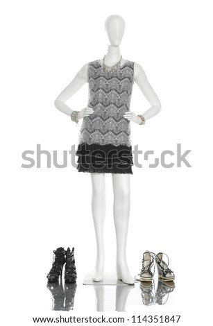 full-length female clothing with boots on mannequin