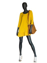 Full-length female mannequin dressed in yellow dress isolated on white background.