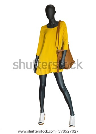 Shutterstock Full-length female mannequin dressed in yellow dress isolated on white background.