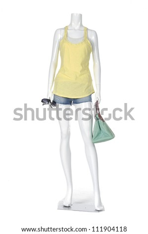Full length female mannequin in short jeans casual clothes with bag