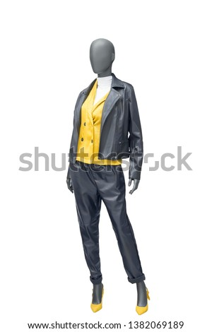 Full-length female mannequin wearing black leather suit, isolated on white background. No brand names or copyright objects.