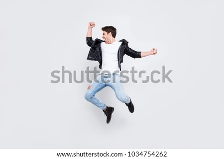 Full-length full-size photo People leisure lifestyle craziness concept. Charismatic energetic handsome enthusiastic lucky confident guy wearing  trendy urban style clothes isolated on white background