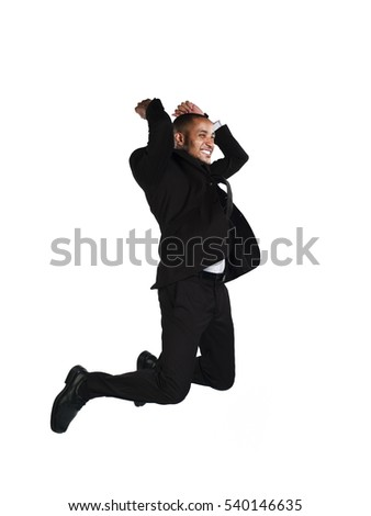 b5cf3920c8 Full length happy business man in black suit jumping in studio isolated on  white background #