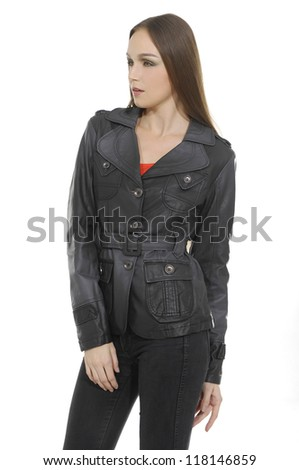 Full length image of an attractive young girl black leather coat standing  posing over white background