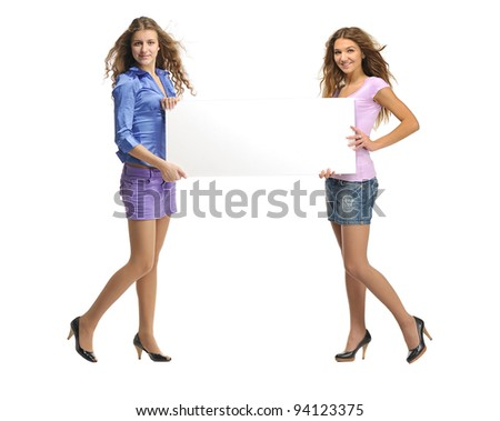 Full length image of   two young women  with billboard over white background
