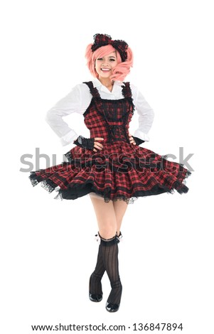 Full-length isolated portrait of a kawaii girl in tartan dress with flying skirt