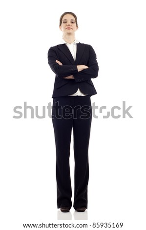 Full length of a confident young business woman standing with folded hands isolated on white background