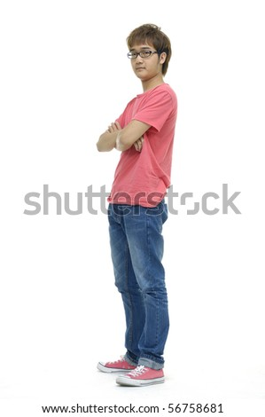 Full length of a happy young guy standing against isolated white background