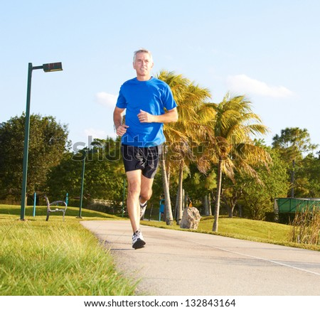 Full length of a mature man jogging Horizontal shot
