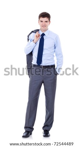 Full length of a relaxed young business man holding coat over shoulders isolated on white background