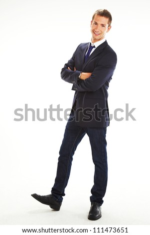 Full length of a smiling young businessman standing against isolated white background