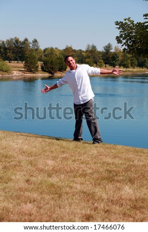 full length of African-American teen boy outside by lake