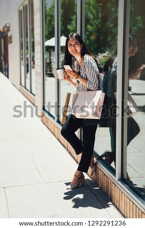 6f5ae03ebcd full length of asian woman spending leisure time in shopping mall in  stanford. young girl