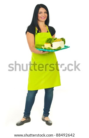 Full length of attractive cheese maker female holding full plateau with different type of cheese isolated on white background