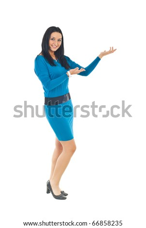 Full length of attractive woman in blue tight dress making presentation to copy space isolated on white background
