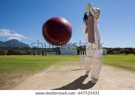 Photo of  Full length of batsman playing cricket on pitch against blue sky during sunny day