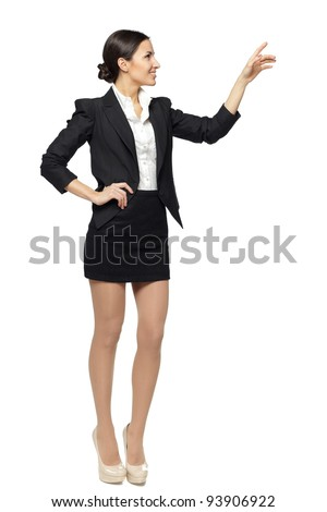 Full length of beautiful  business woman showing copy space over white background