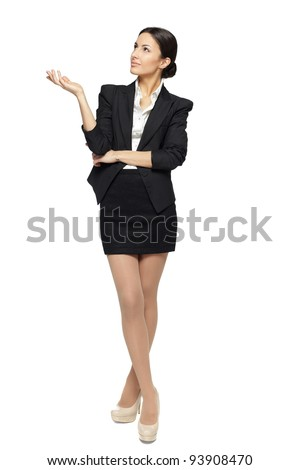 Full length of beautiful business woman showing copy space up over white background - stock photo