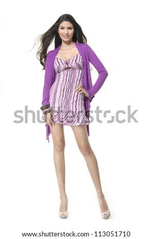 Full length of beautiful female posing in elegant dress